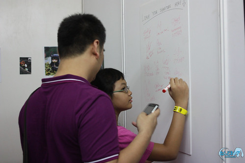 A visitor is putting her signature in the Guest Signature Board