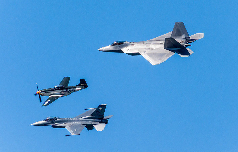 The Fighters F-22A Raptor, F-15 Fighting Falcon, and P-40