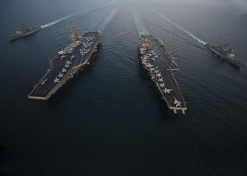 USS Enterprise, USS Dwight D. Eisenhower, USS Vicksburg and USS Hue City are underway in formation. by Official U.S. Navy Imagery
