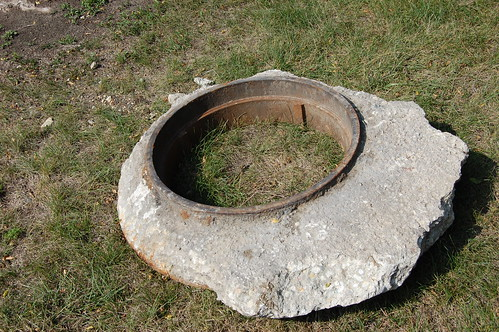 removed metal ring for manhole with cement