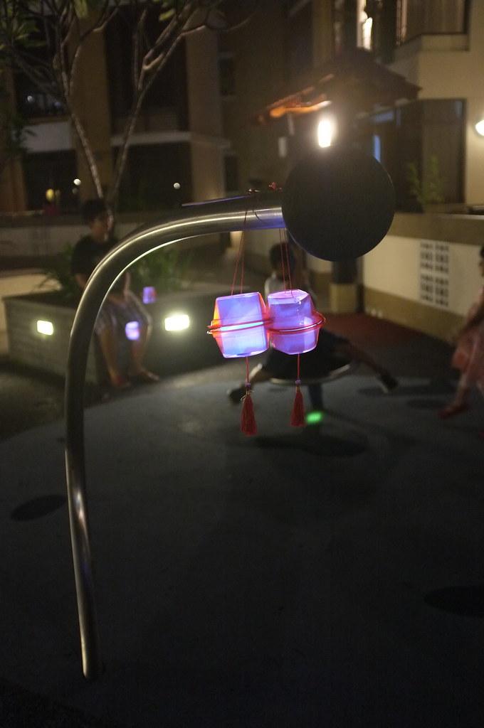 playground at night, with lanterns
