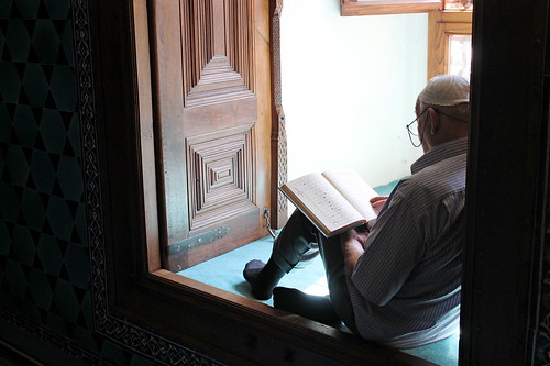 Man reading in Green Mosque