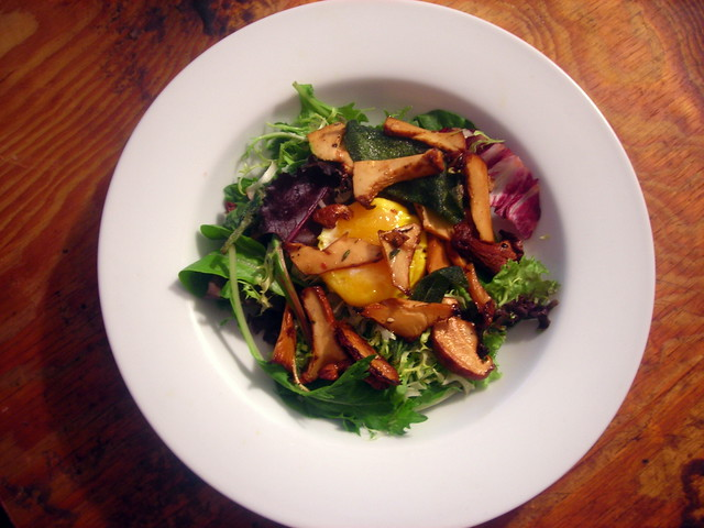 Chanterelle and fried herb salad, with farm egg fried in olive oil