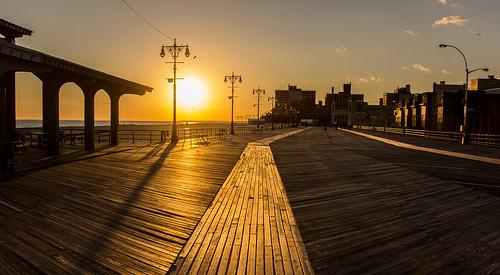 Coney Island Photo Walk - Sunset on Boardwalk by Bob Jagendorf