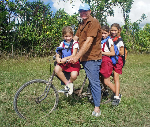 A Cuban Family Travelling By Bicycle