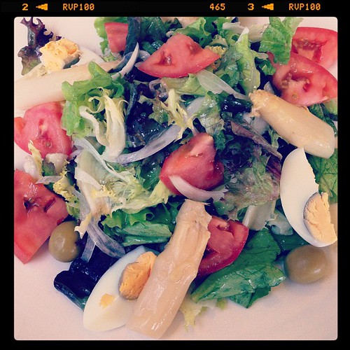 salad with asparagus, olives, eggs and tomatoes