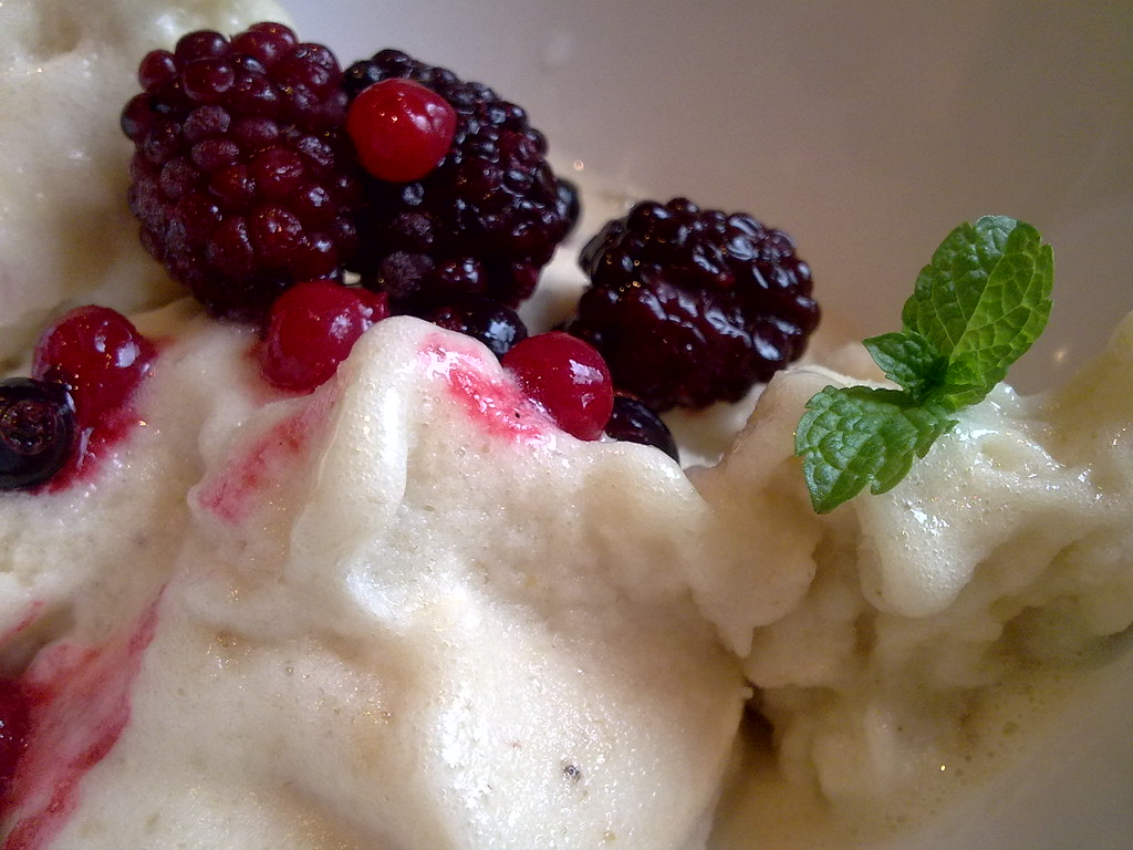 Raw vegan banana ice cream with frozen berries