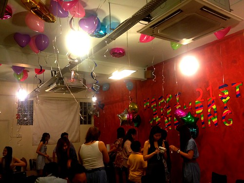 colourful balloons, cosy red wall