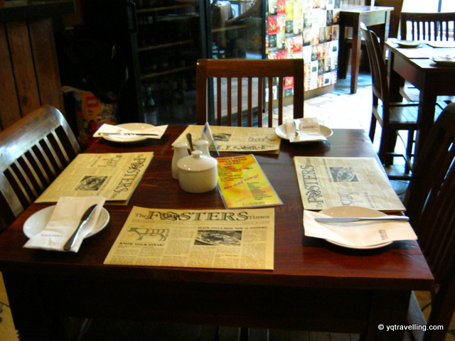 Setting of Fosters, an English Rose Café. Menu opens like a paper