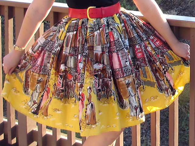 Detail of the skirt. I absolutely adore this 19th century New Orleans French Quarter scene! (Photo by Pat Zimmerman.)