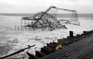 What's left of the Jetstar from Casino Pier sits in the ocean in Seaside Heights, New Jersey Tuesday 10-30-12 photo by David Gard