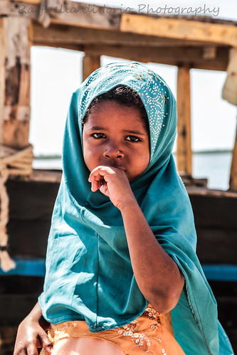 Lamu, small girl. by Raffaella di Iorio Photography
