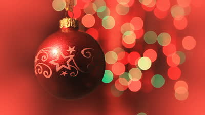 stock-footage-christmas-ball-rotates-at-the-background-of-blurred-night-lights