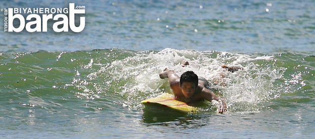 surfing in real quezon tignoan beach