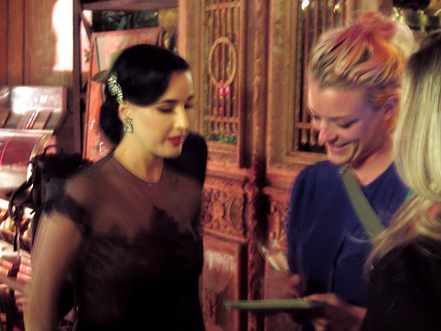 Dita von Teese chats with a reporter.