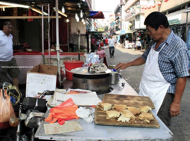 Vendor in Chinatown Petaling Street Kuala Lumpur