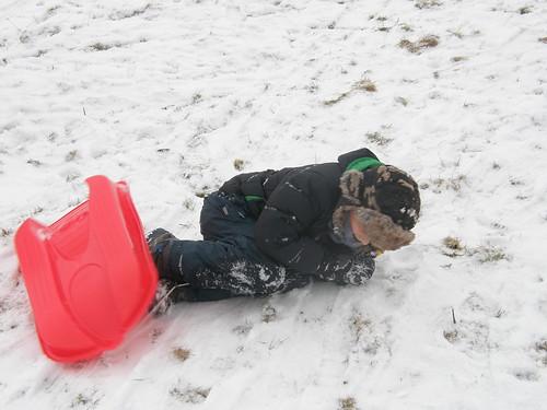 Falling off sledge.