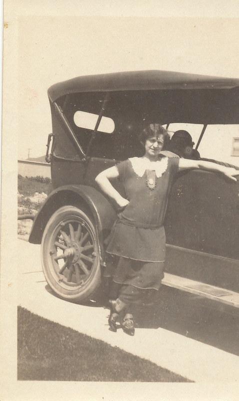 Aunt Rose leaning on Jack G's car