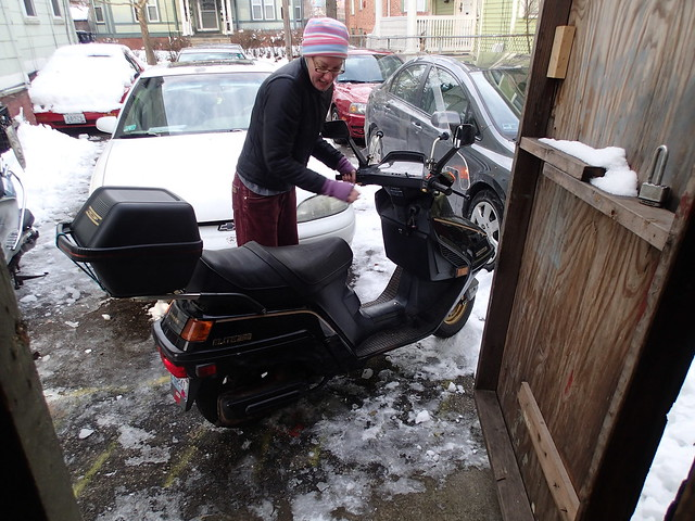 Maneuvering the Honda Elite out of the garage on the ice...oh yeah, wintah in New England