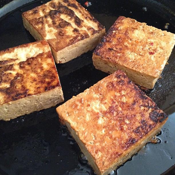 Frying up some marinated tofu.