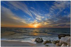 a majestic sunset at Tel Aviv port