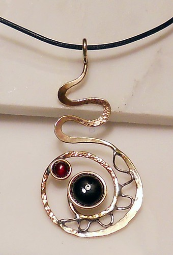 pendant nugold,nickel silver, onyx14mm,garnet 7mm, leather cord by Wolfgang Schweizer