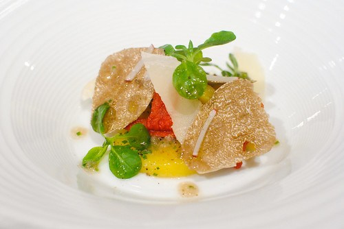Potato salad served with tomato confit, parmesan shavings and autumn truffle