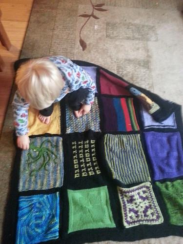 Owen checks out his birthday afghan by marymactavish