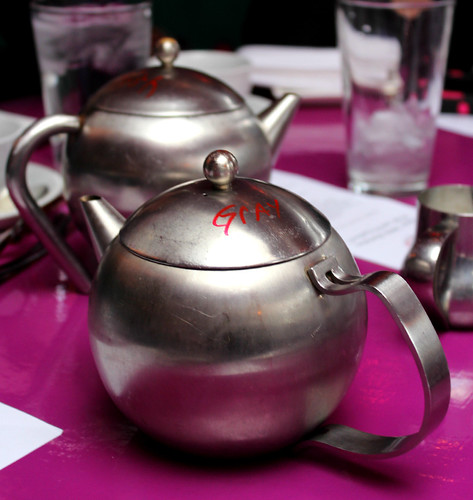 "All tea was served in metal pots. They were labeled as ""Gray,"" ""English,"" and ""Rose"" to distinguish the pots of Earl Grey, English breakfast, and rose tea."