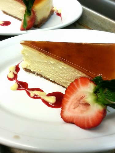 apricot glazed cheesecake slice with raspberry and lemon sauce by pipsyq