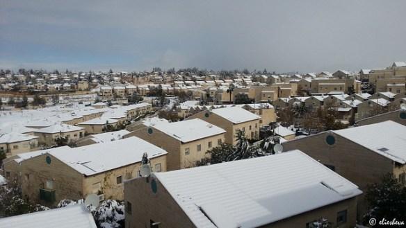 Tzur Hadassah wearing snow and sun.