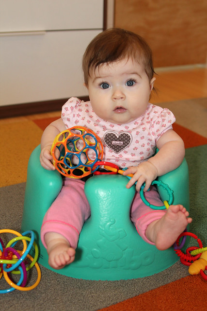 Playing in the bumbo