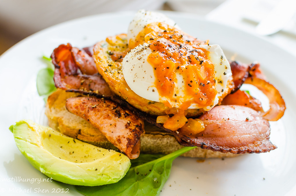 Lumiere Cafe - corn cake stack with poached eggs, bacon, avocado & homemade tomato relish served on sourdough toast
