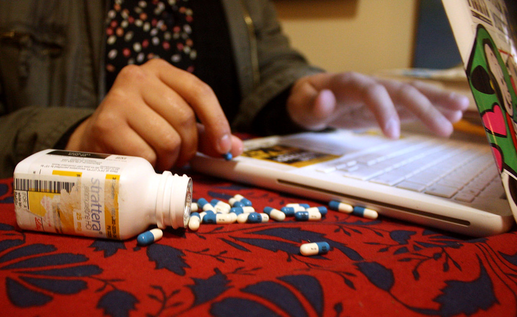 The prescription drug Strattera is a common focusing drug used to treat ADHD and is similar to Adderall or Ritalin. Students often use these drugs for late night studying or essay writing. Photo by Maggie Rose Ortins / Special to Xpress