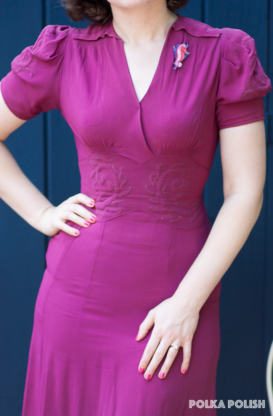 Bold magenta 1940s dress featuring an embroidered waistband