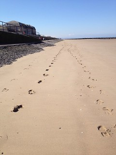 Two sets of footprints in the sand. Barkby Beach, Prestatyn, North Wales