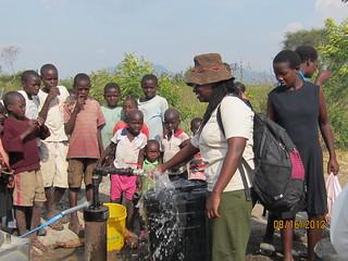 Moureen by water spigot Nyatemba