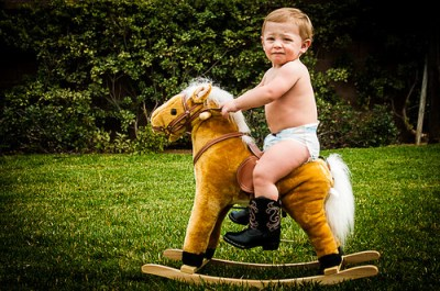 cute baby boy on rocking horse