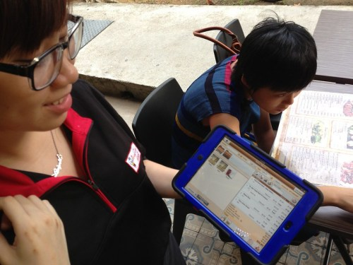 Living in the future. Thai waitress took order with iPad