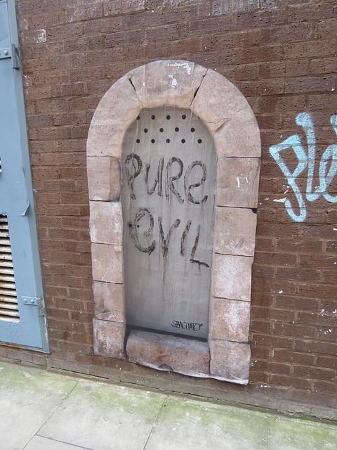 Shoreditch street art - Pure Evil