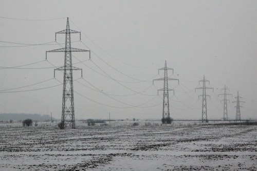 Transmission lines in the snow covered Romanian countryside