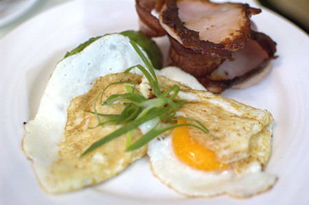 Two fried free-range eggs with avocado and bacon