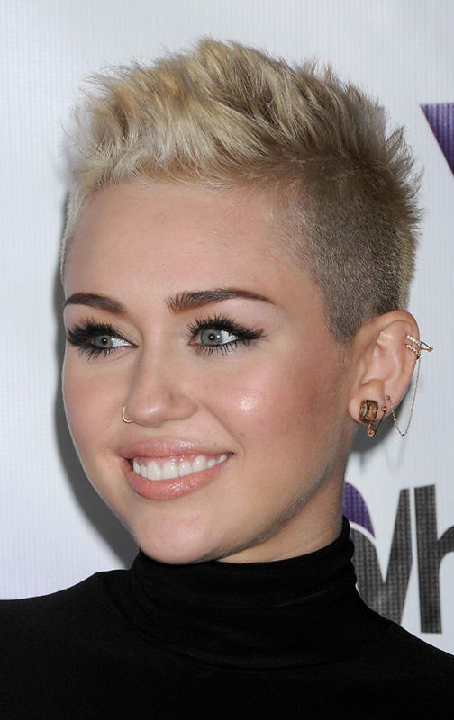 Miley Cyrus wearing Ear Cuffs