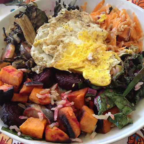 Rice bowl! Brown rice, chard, root veggies, pickled greens, shredded carrots, and fried egg. #lunchtime