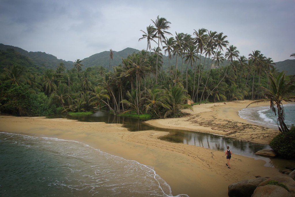An early morning ramble on the jungle-clad beaches of the Tayrona National Park, Carribean Colombia.