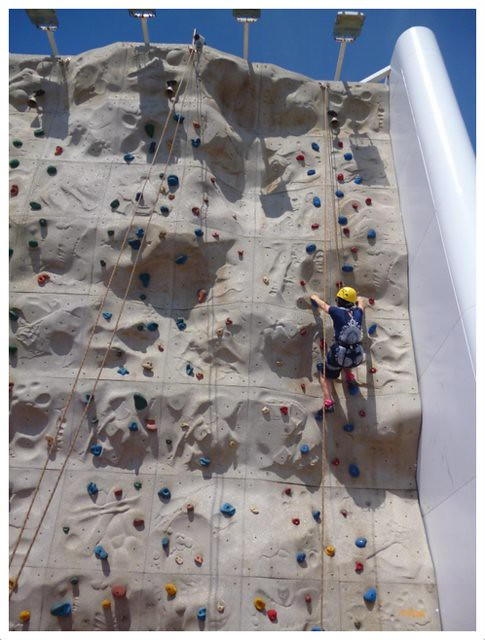 Riding a motorcycle on the rock climbing wall