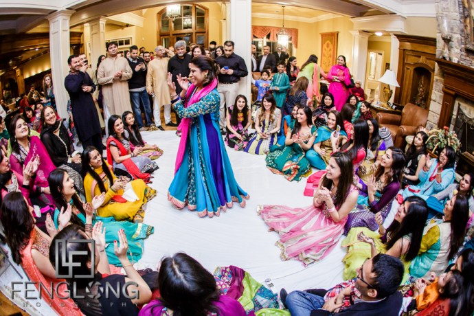 Guests dancing on bride's side during mehndi night