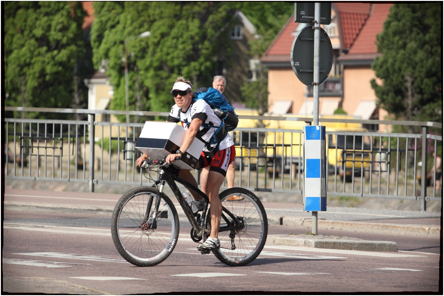 Biker with a big square Box