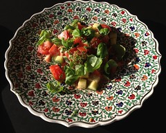 Tomato-basil salad with creamy basil dressing