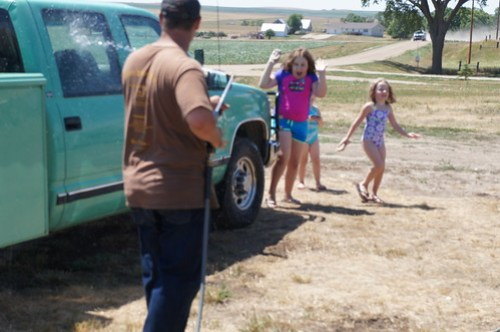 Having a little fun spraying the girls with water!
